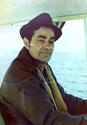 man on boat with brown jacket and hat